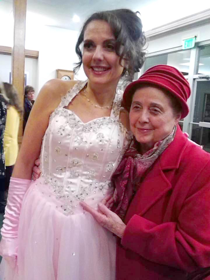 Photo of Elizabeth Montgomery in pink dress and her mom in red coat and hat